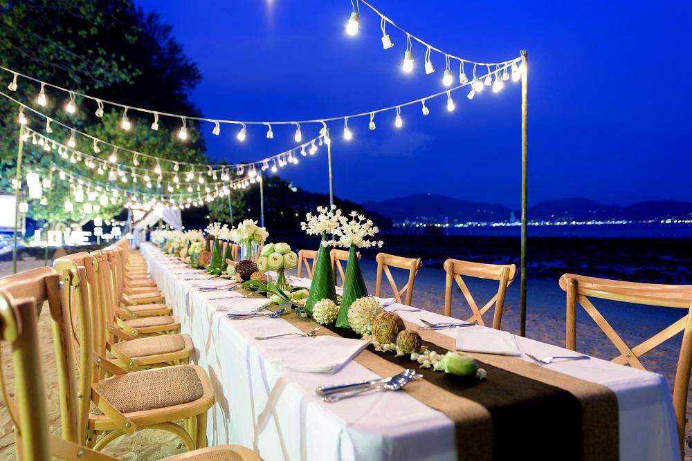 Wedding table with lights on beach
